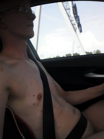 Nude behind the wheel