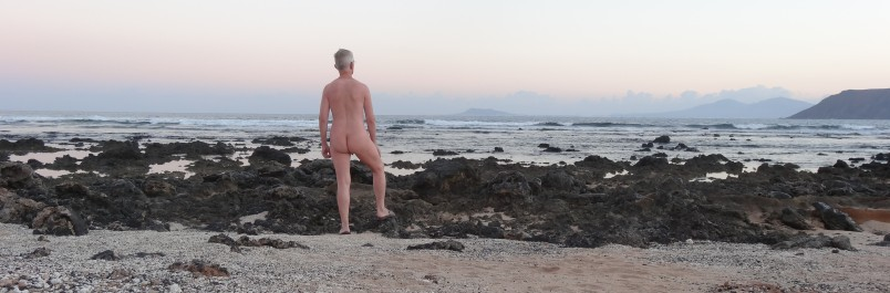 At the beach. Clothing optional.