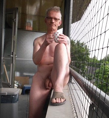 Coffee, nude on the balcony
